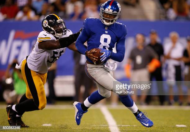 Quarterback Josh Johnson of the New York Giants is chased by Arthur Moats of the Pittsburgh Steelers during the first quarter of an NFL preseason...