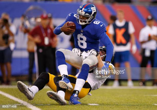 Quarterback Josh Johnson of the New York Giants is sacked by TJ Watt of the Pittsburgh Steelers during the first quarter of an NFL preseason game at...