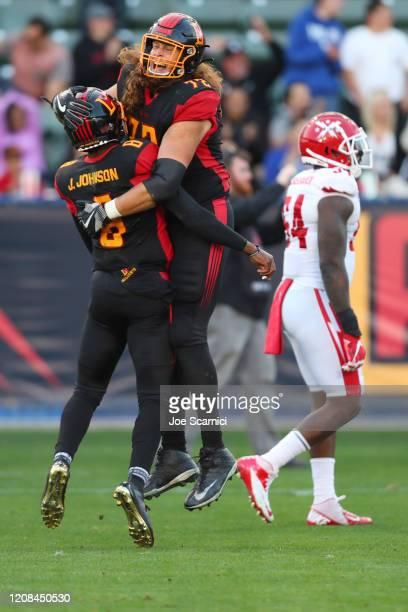 Quarterback Josh Johnson of the LA Wildcats and Storm Norton of the LA Wildcats celebrate a touchdown in the third quarter against the DC Defenders...
