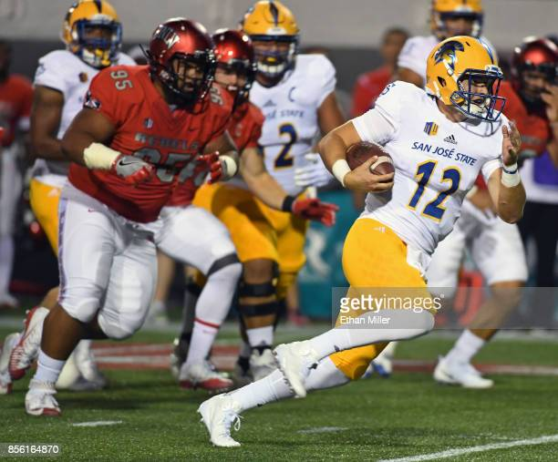 Quarterback Josh Love of the San Jose State Spartans rushes against the UNLV Rebels during their game at Sam Boyd Stadium on September 30 2017 in Las...