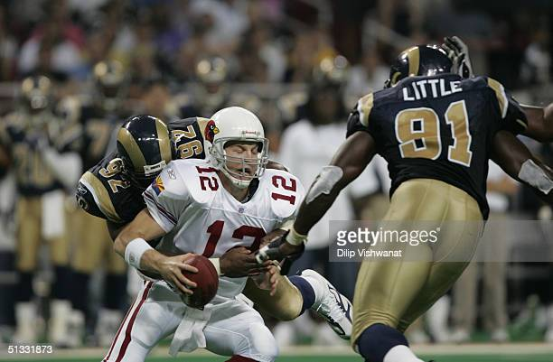 Quarterback Josh McCown of the Arizona Cardinals is sacked by Damione Lewis of the St Louis Rams during the game on September 12 2004 at Edward Jones...