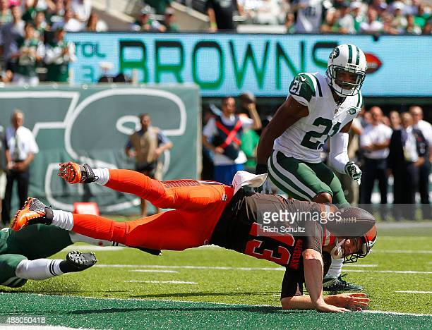 Quarterback Josh McCown of the Cleveland Browns fumbles at the goal line after being hit by Calvin Pryor of the New York Jets as Marcus Gilchrist...