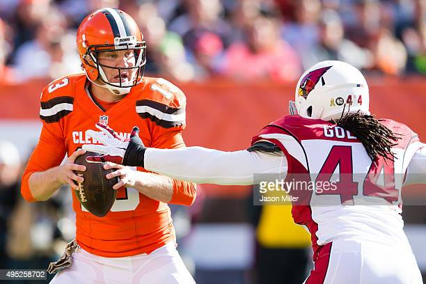 Quarterback Josh McCown of the Cleveland Browns looks for a receiver while under pressure from outside linebacker Markus Golden of the Arizona...