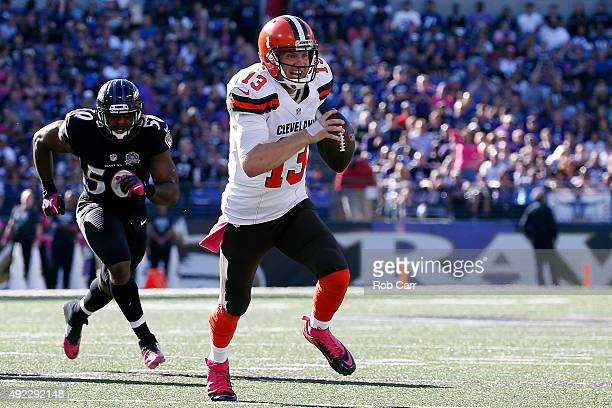Quarterback Josh McCown of the Cleveland Browns scores a third quarter touchdown past outside linebacker Albert McClellan of the Baltimore Ravens...