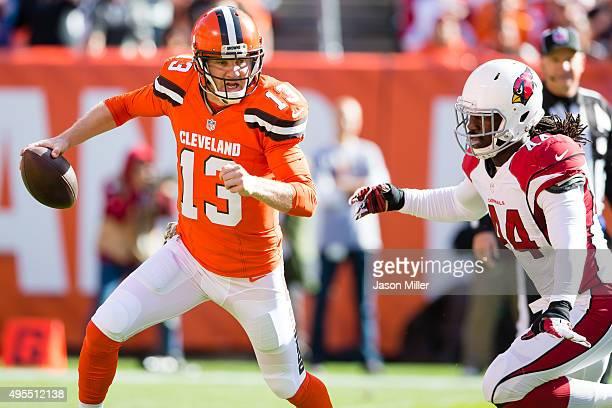 Quarterback Josh McCown of the Cleveland Browns scrambles from outside linebacker Markus Golden of the Arizona Cardinals during the first half at...