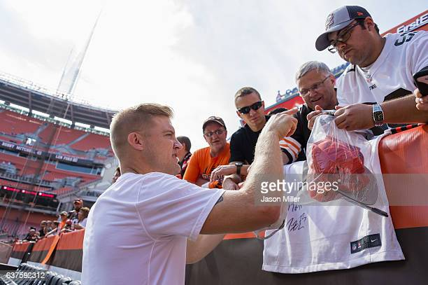 Quarterback Josh McCown of the Cleveland Browns signs autographs for fans prior to the game against the Baltimore Ravens at FirstEnergy Stadium on...