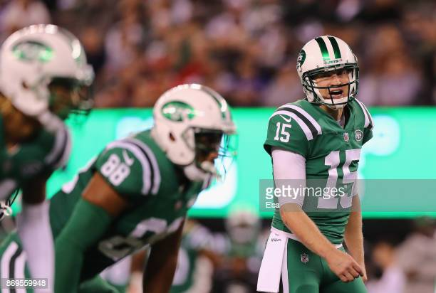 Quarterback Josh McCown of the New York Jets makes a call while playing against the Buffalo Bills during the first quarter of the game at MetLife...
