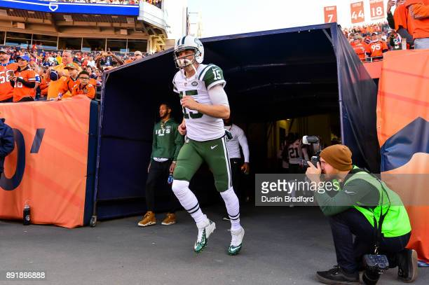 Quarterback Josh McCown of the New York Jets runs onto the field before a game against the Denver Broncos at Sports Authority Field at Mile High on...