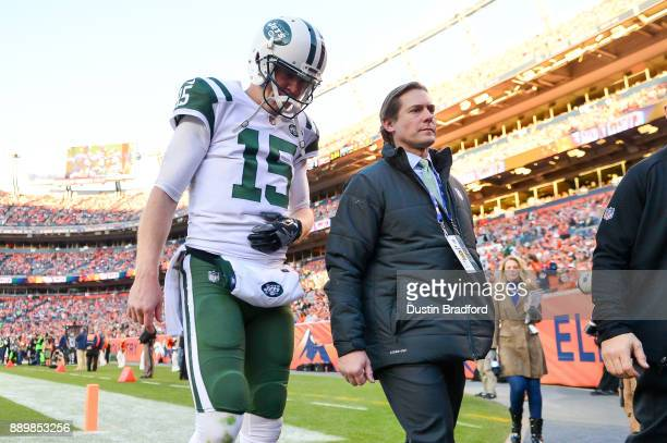 Quarterback Josh McCown of the New York Jets walks off the field with a trainer after sustaining an injury in the third quarter of a game against the...