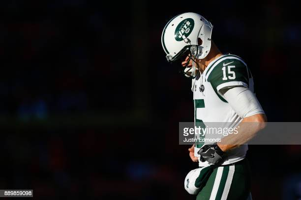 Quarterback Josh McCown of the New York Jets walks on the field between plays against the Denver Broncos at Sports Authority Field at Mile High on...