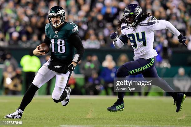 Quarterback Josh McCown of the Philadelphia Eagles is runs for a first down over Ezekiel Ansah of the Seattle Seahawks during the NFC Wild Card...