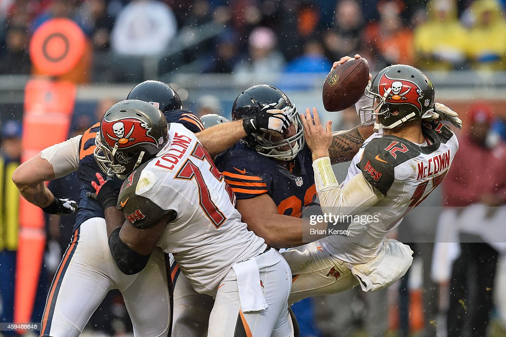 Quarterback Josh McCown #12 of the Tampa Bay Buccaneers is sacked by defensive tackle Stephen Paea #92 of the Chicago Bears in the third quarter at Soldier Field on November 23, 2014 in Chicago, Illinois.