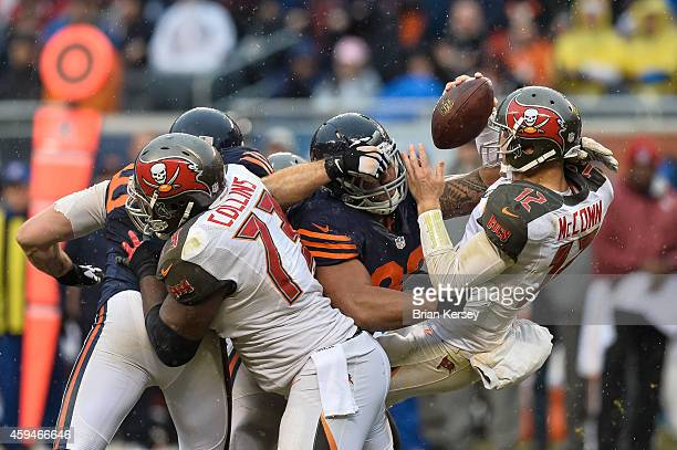 Quarterback Josh McCown of the Tampa Bay Buccaneers is sacked by defensive tackle Stephen Paea of the Chicago Bears in the third quarter at Soldier...