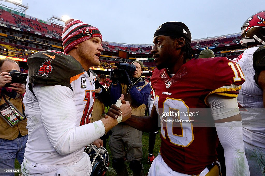 Quarterback Josh McCown #12 of the Tampa Bay Buccaneers shakes hands withquarterback Robert Griffin III #10 of the Washington Redskins after the Tampa Bay Buccaneers defeated the Washington Redskins 27-7 at FedExField on November 16, 2014 in Landover, Maryland.