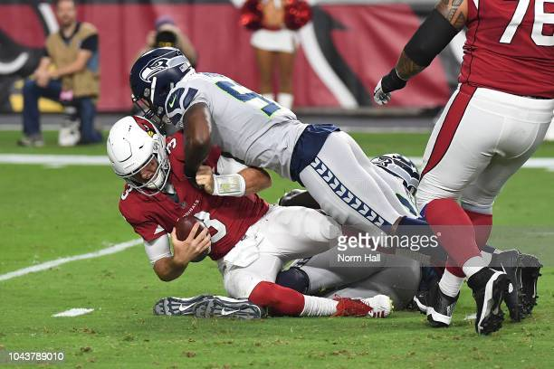Quarterback Josh Rosen of the Arizona Cardinals is sacked by linebacker Barkevious Mingo of the Seattle Seahawks during the first quarter at State...