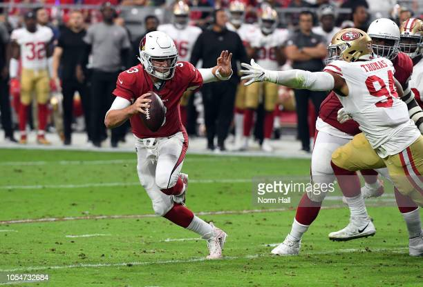 Quarterback Josh Rosen of the Arizona Cardinals runs past defensive end Solomon Thomas of the San Francisco 49ers during the second quarter at State...