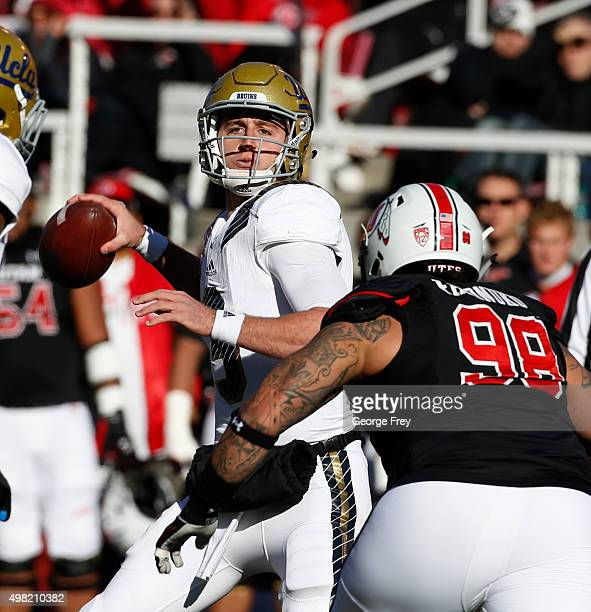 Quarterback Josh Rosen of the UCLA Bruins looks to pass the ball as Viliseni Fauonuku of the Utah Utes zeros in during the first half of a college...