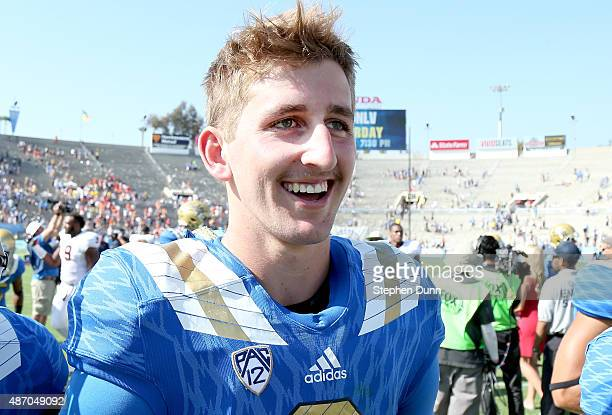 Quarterback Josh Rosen of the UCLA Bruins smiles as he walks off the field after the game with the Virginia Cavaliers at the Rose Bowl on September 5...