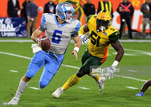 Quarterback Josh Woodrum of the Salt Lake Stallions is chased by Edmond Robinson of the Arizona Hotshots during the first half of the Alliance of...