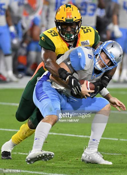 Quarterback Josh Woodrum of the Salt Lake Stallions is sacked by Da'Sean Downey of the Arizona Hotshots during the second quarter of the Alliance of...