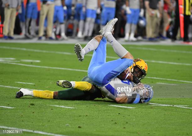 Quarterback JoshÊWoodrum of the Salt Lake Stallions is sacked by Da'SeanÊDowney of the Arizona Hotshots during the second quarter of the Alliance of...