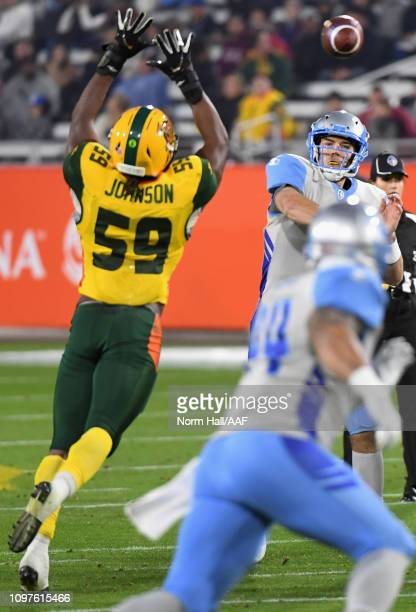Quarterback Josh Woodrum of the Salt Lake Stallions passes the ball over Da'Sean Downey of the Arizona Hotshots during the Alliance of American...