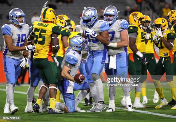 Quarterback Josh Woodrum of the Salt Lake Stallions reacts after scoring on a two point conversion during the first half of the Alliance of American...