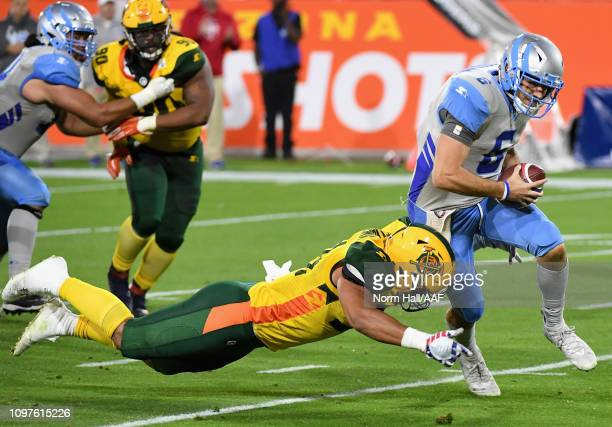 Quarterback Josh Woodrum of the Salt Lake Stallions tries to avoid the sack during the Alliance of American Football game against the Arizona...