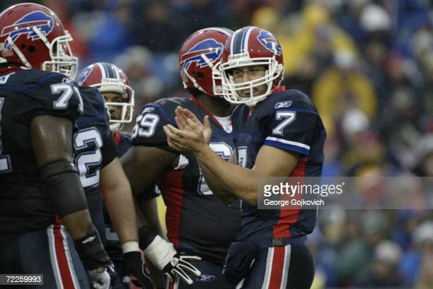 Quarterback JP Losman of the Buffalo Bills claps his hands in the huddle as rain falls during a game against the New England Patriots at Ralph Wilson...