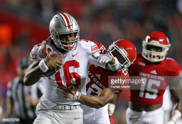Quarterback JT Barrett of the Ohio State Buckeyes carries the ball during a game against the Rutgers Scarlet Knights on September 30 2017 at High...