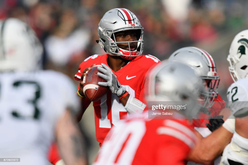 Quarterback J.T. Barrett #16 of the Ohio State Buckeyes looks for his receiver in the third quarter against the Michigan State Spartans at Ohio Stadium on November 11, 2017 in Columbus, Ohio. Ohio State defeated Michigan State 48-3.