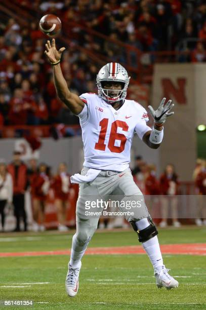 Quarterback JT Barrett of the Ohio State Buckeyes passes against the Nebraska Cornhuskers at Memorial Stadium on October 14 2017 in Lincoln Nebraska