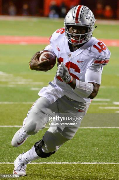 Quarterback JT Barrett of the Ohio State Buckeyes runs against the Nebraska Cornhuskers at Memorial Stadium on October 14 2017 in Lincoln Nebraska