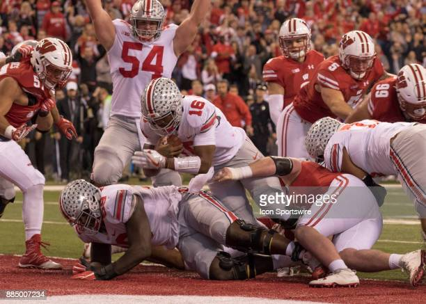 Quarterback JT Barrett of the Ohio State Buckeyes scores a touchdown during the Big 10 Championship Game between the Ohio State Buckeyes and the...