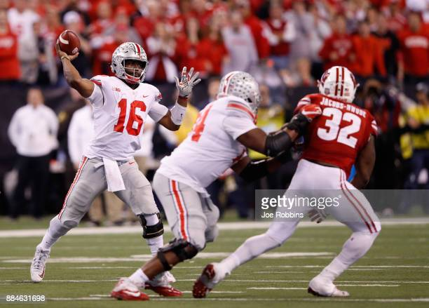 Quarterback JT Barrett of the Ohio State Buckeyes throws a pass against the Wisconsin Badgers during the Big Ten Championship game at Lucas Oil...