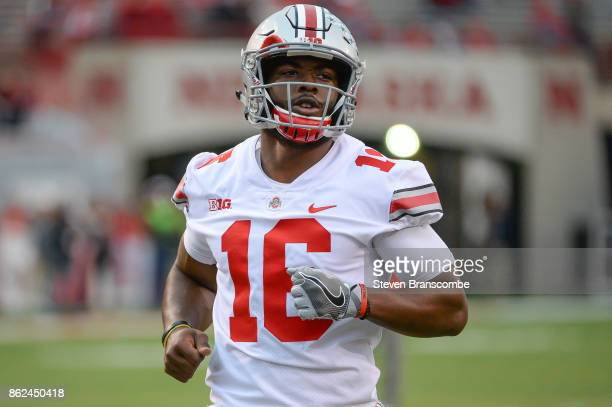 Quarterback JT Barrett of the Ohio State Buckeyes warms up before the game against the Nebraska Cornhuskers at Memorial Stadium on October 14 2017 in...