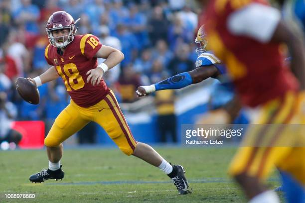 Quarterback JT Daniels of the USC Trojans looks for an opening during the second half of a football game at Rose Bowl on November 17 2018 in Pasadena...