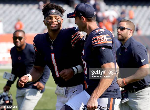 Quarterback Justin Fields and punter Pat O'Donnell of the Chicago Bears celebrate after the 20-17 win over the Cincinnati Bengals at Soldier Field on...