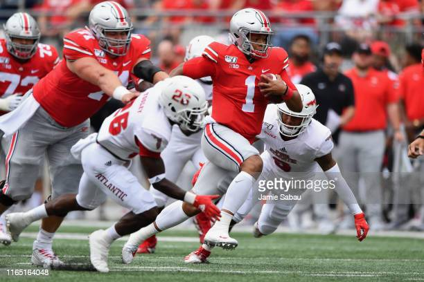 Quarterback Justin Fields of the Ohio State Buckeyes breaks free for a 51yard touchdown run in the first quarter against the Florida Atlantic Owls at...