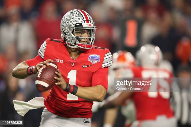 Quarterback Justin Fields of the Ohio State Buckeyes drop back to pass during the PlayStation Fiesta Bowl against the Clemson Tigers at State Farm...