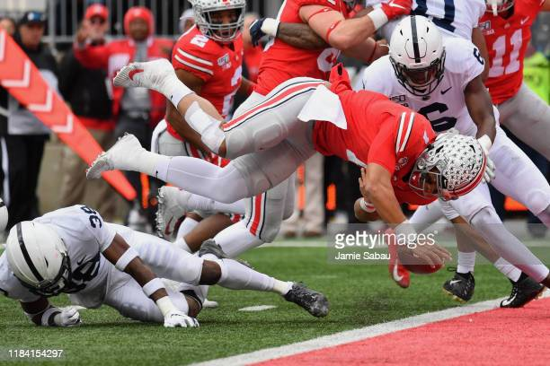 Quarterback Justin Fields of the Ohio State Buckeyes fumbles the ball at the goal line after being upended by Lamont Wade of the Penn State Nittany...