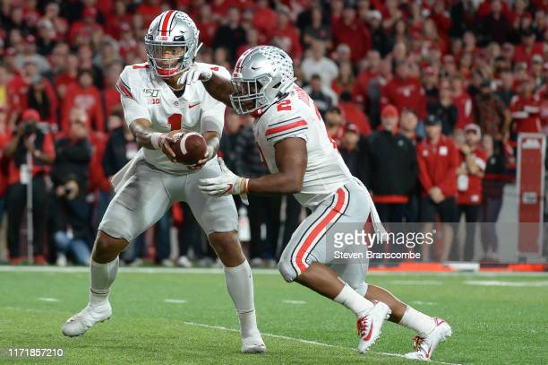 Quarterback Justin Fields of the Ohio State Buckeyes hands off to running back JK Dobbins in the game against the Nebraska Cornhuskers at Memorial...