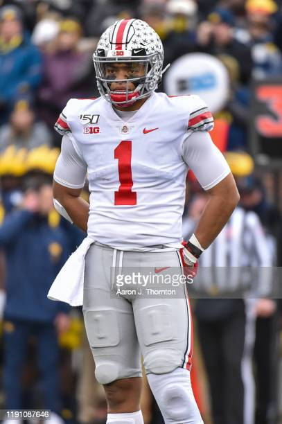 Quarterback Justin Fields of the Ohio State Buckeyes looks for the play call during the first half of a college football game against the Michigan...