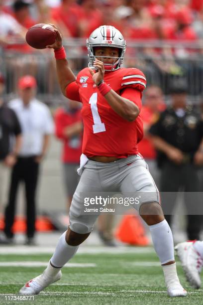 Quarterback Justin Fields of the Ohio State Buckeyes passes against the Cincinnati Bearcats at Ohio Stadium on September 7 2019 in Columbus Ohio