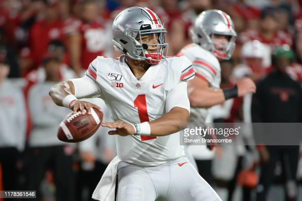 Quarterback Justin Fields of the Ohio State Buckeyes passes against the Nebraska Cornhuskers at Memorial Stadium on September 28 2019 in Lincoln...