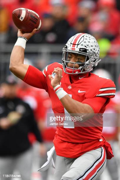 Quarterback Justin Fields of the Ohio State Buckeyes passes in the first quarter against the Penn State Nittany Lions at Ohio Stadium on November 23...