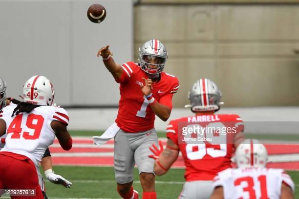 Quarterback Justin Fields of the Ohio State Buckeyes passes to Luke Farrell in the second quarter against the Nebraska Cornhuskers at Ohio Stadium on...