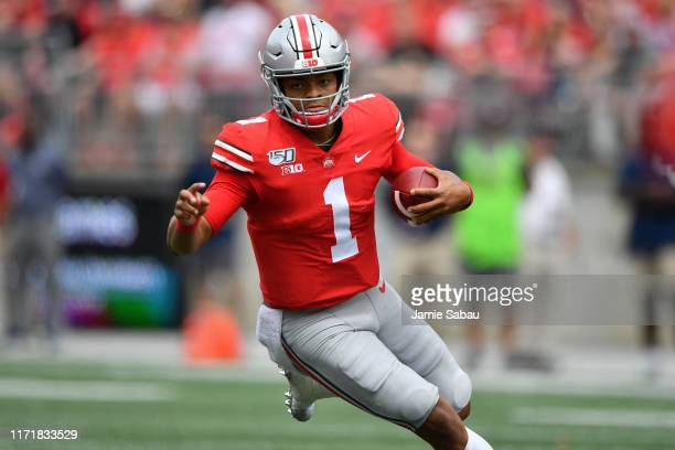 Quarterback Justin Fields of the Ohio State Buckeyes runs with the ball against the Florida Atlantic Owls at Ohio Stadium on August 31 2019 in...