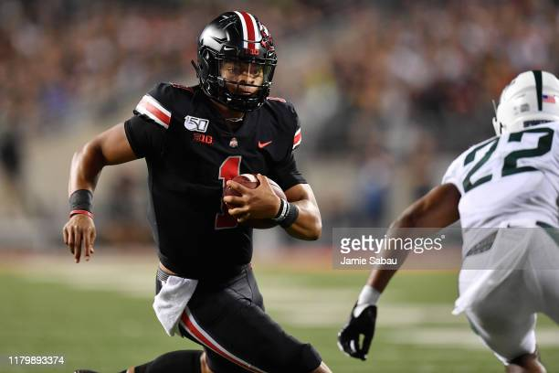 Quarterback Justin Fields of the Ohio State Buckeyes runs with the ball against the Michigan State Spartans at Ohio Stadium on October 5 2019 in...