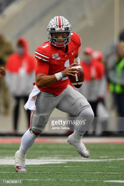 Quarterback Justin Fields of the Ohio State Buckeyes runs with the ball against the Penn State Nittany Lions at Ohio Stadium on November 23 2019 in...